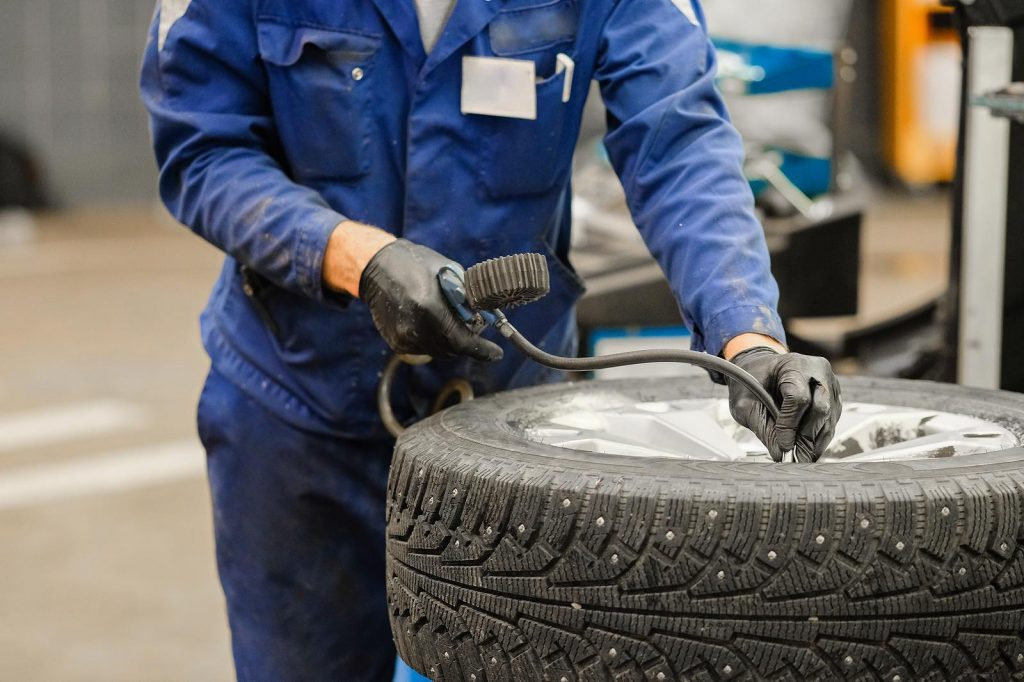 Picture of person putting air into tyre